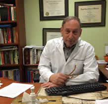 Above: Dr Ron Ruden at his desk (originator of Havening Techniques)